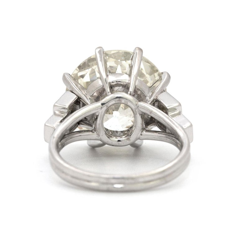 A custom made 8 prong platinum ring featuring a 9.58 carat Old European Cut diamond that is beautifully accented with 6 straight baguette shaped diamonds that weigh 0.60 carats.         Size 5 3/4