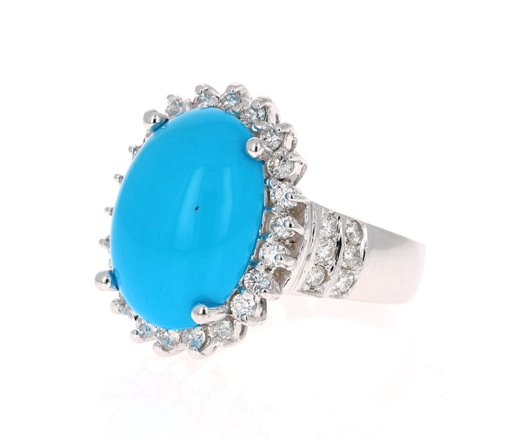 The Oval Cut Turquoise is 8.55 Carats and is surrounded by a Halo of beautifully set diamonds.  There are 36 Round Cut Diamonds that weigh 1.15 Carats (Clarity: SI2, Color: F). The total carat weight of the ring is 9.70 Carats.  The ring is crafted