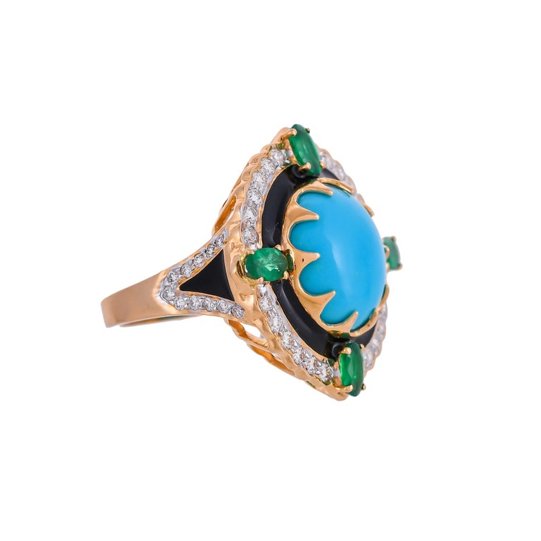 Modern and stylish this 18 karat ring features a bold, geometric shape set with the eccentric combination of 9.70 carats turquoise surrounded by sparkling white 0.71 carats diamonds enhanced with 0.79 carats emeralds and solid black enamel,