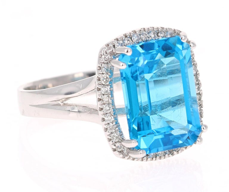 This beautiful Emerald Cut Blue Topaz and Diamond ring has a simple but stunning large Blue Topaz that weighs 9.44 Carats. It is surrounded by 38  Round Cut Diamonds that weigh 0.27 Carats. The total carat weight of the ring is 9.44 Carats.  The