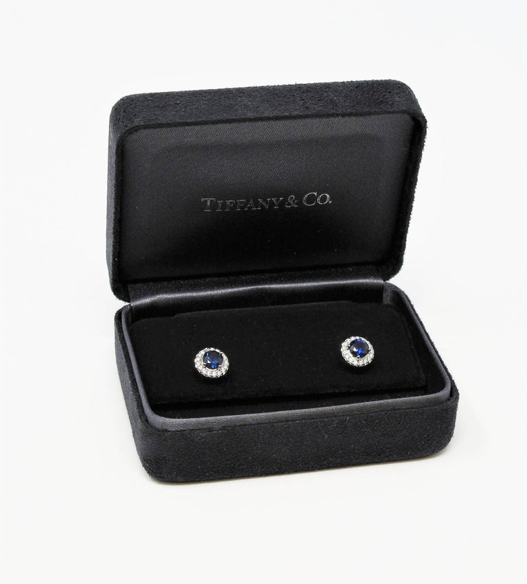 Gorgeous sapphire and diamond stud earrings with a sophisticated modern twist. These gorgeous diamond halo studs offer substantial sparkle and glamour without being over the top, while their simple yet elegant design can be worn with just about
