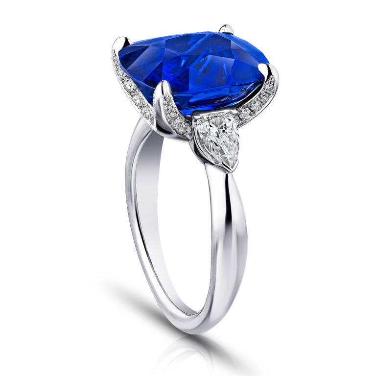 9.81 carat cushion blue sapphire with arrow shaped diamonds .67 carats set in a platinum ring. Size 7. Free resizing to your finger size. This ring is breathtaking. The center stone has a huge look. Its totally clean and has excellent color