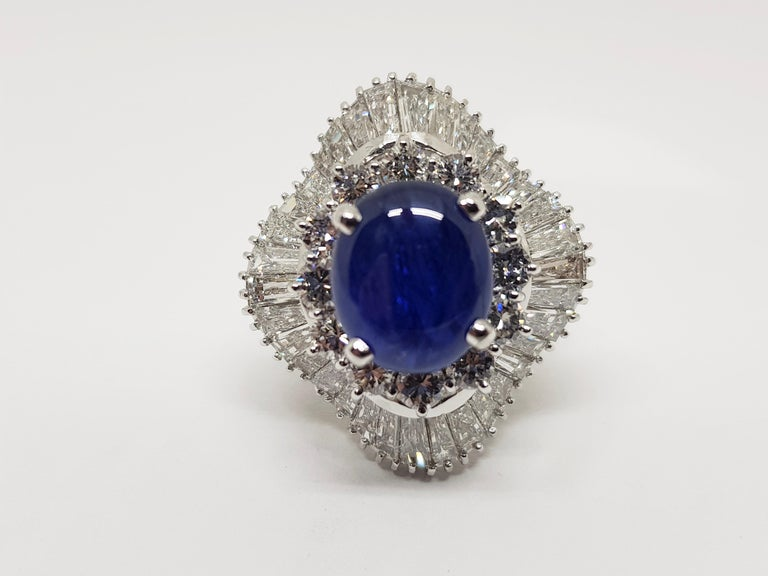 Gold: 18 carat white gold  Weight: 19.35gr.  Sapphire: 4.03 ct. Cabochon Cut  Gemstones are commonly treated for colour or clarity Round Diamonds: 1.20ct. Colour: E Clarity: VVS Tapered Baguette Diamonds: 4.60ct. Colour: E Clarity: VVS Width: