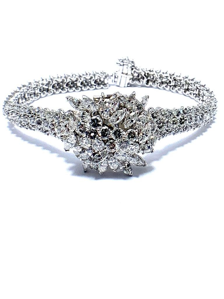 Round Cut 9.85 Carat Diamond Encrusted Universal Geneve Platinum Watch For Sale