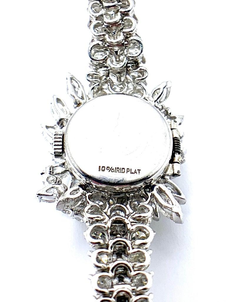 Women's or Men's 9.85 Carat Diamond Encrusted Universal Geneve Platinum Watch For Sale