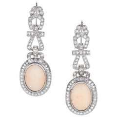 9.89 Carat Oval Shaped Angel Skin Coral and Diamond Earrings in Platinum