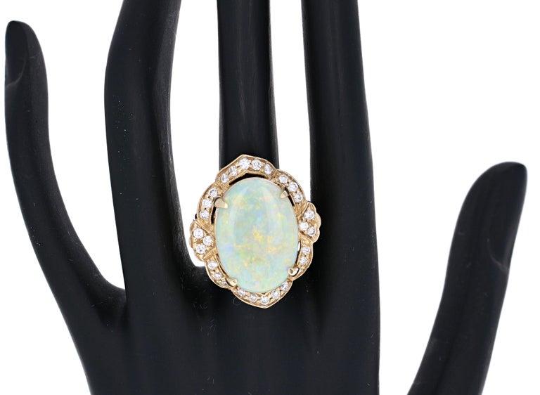 Oval Cut 9.93 Carat Opal Diamond 14 Karat Yellow Gold Ring For Sale