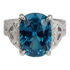 9.98 Carat Oval Cut Blue Zircon and 0.54 Carat Diamond Ring