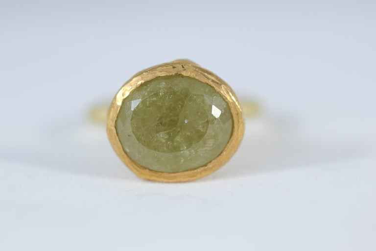 Lotus Leaf Ring. A whimsical stackable cocktail ring featuring Russian demantoid garnet solitaire set in a 21k solid gold bezel mounted on 18k solid gold rounded shank. The bottom of the bezel is set with rose cut yellow diamonds.  This ring is hand