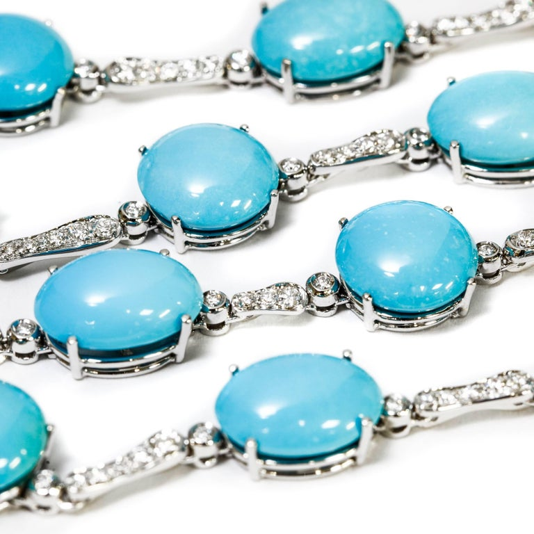 This A & Furst drop necklace features 98.50 ct. round and oval cabochon cut turquoise stones as well as 1.63 ct. pave-set round diamonds in 18k white gold. It is in perfect condition and looks new. The length is adjustable (see photos).  We have the