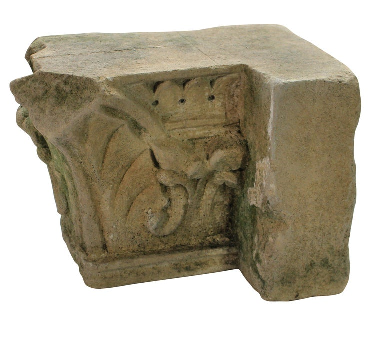 An English classically carved limestone architectural fragment depicting acanthus with traces of paint.