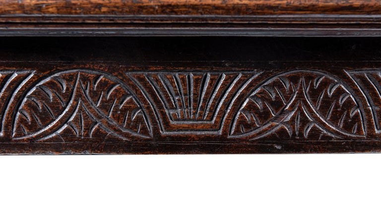The plank top with butt ends, above a recessed and moulded apron, raised on turned legs united by an H stretcher. The date (1656) Inscribed in relief.