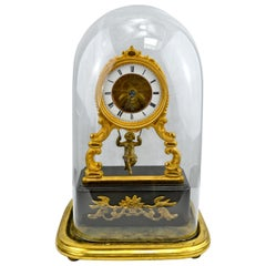 19th Century Glass Domed Gilt Bronze French Mystery Clock with a Swinging Putto