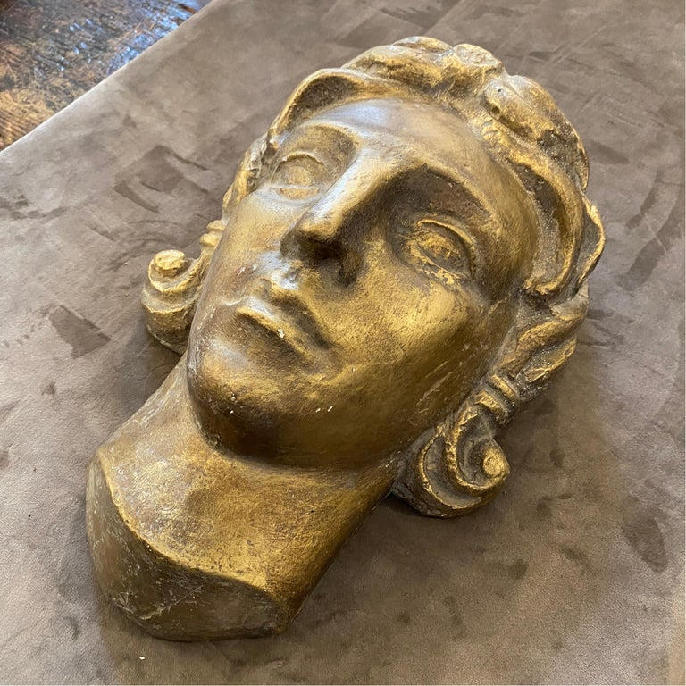 An Art Deco plaster head depicting a face of a woman or a young boy. It has been made in Italy in the 1930s.