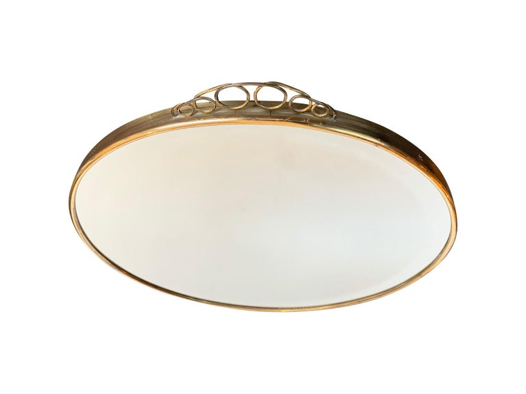Mid-Century Modern 1950s Italian Circular Mirror with Bevelled Glass, Brass Frame and Top Detail For Sale