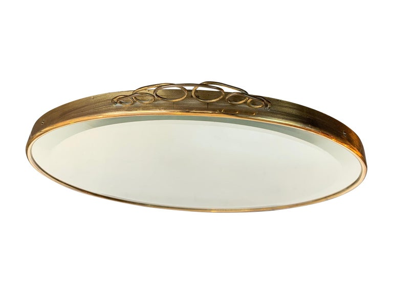 Mid-20th Century 1950s Italian Circular Mirror with Bevelled Glass, Brass Frame and Top Detail For Sale