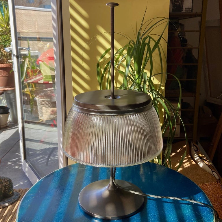 A smart 1960's desk or table lamp, silver grey colour metal and moulded glass, attributed to Tito Agnoli for O-Luce. Some wear and tear. Good working order.