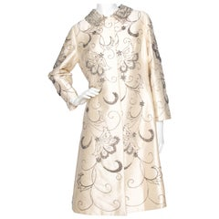 A 1960s Ivory Silk Couture Coat With Beads and Embellishment
