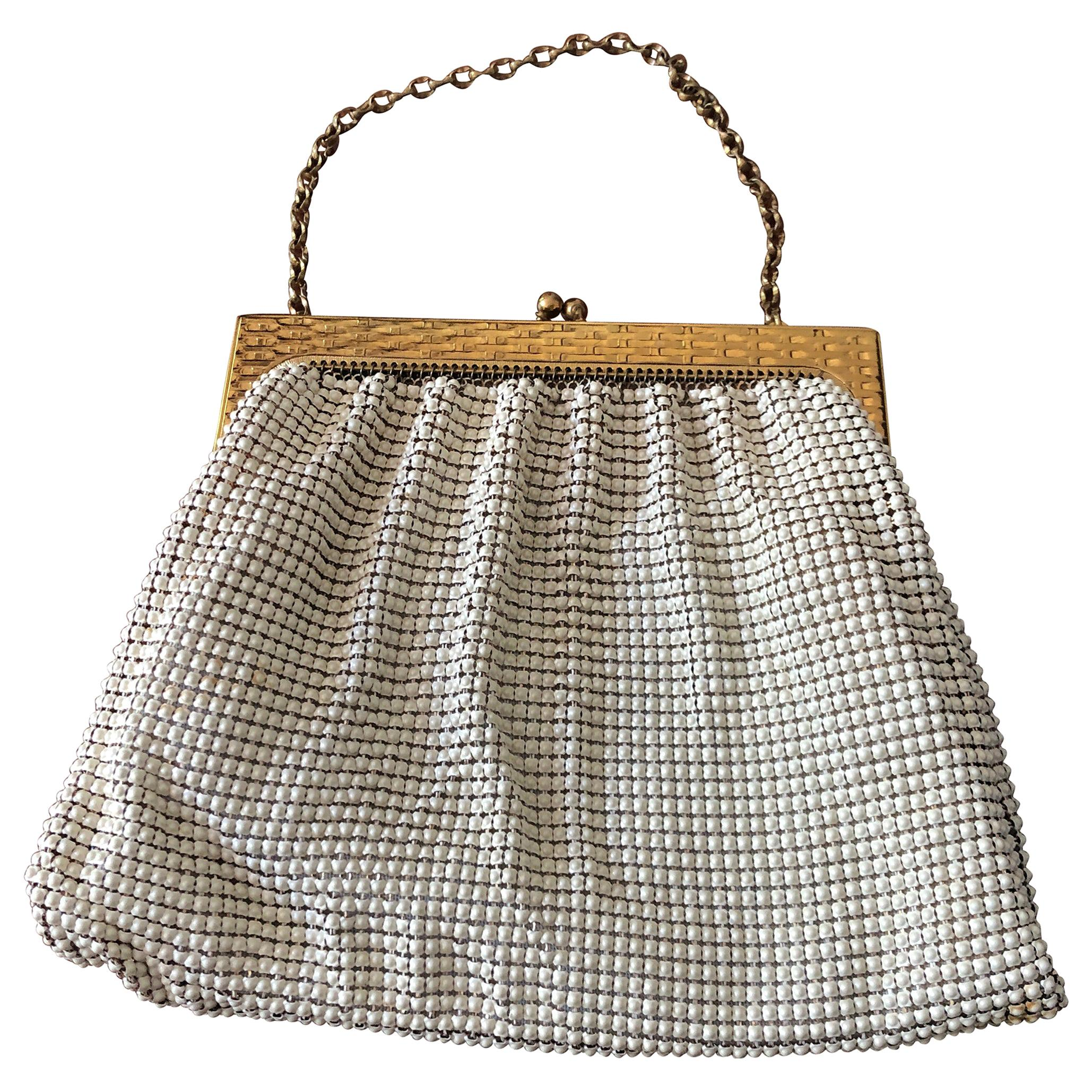 A 1960s Whiting & Davis Gold and White Mesh Hand Bag