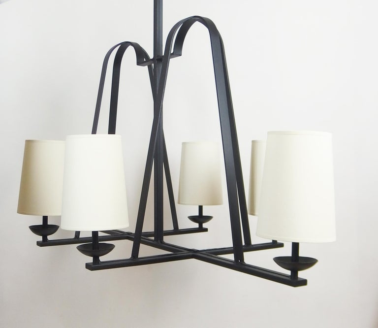 An elegant black enameled wrought iron chandelier with six lights. Rewired. Dimensions without shades: Length 43.70in, depth 24.40in, height 36.22in.