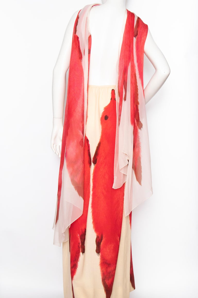 A 1970s Lanvin a-line floor-length ivory skirt and matching scarf ensemble. Both feature a bold fox print.   The size of the skirt corresponds to a modern size Small, but please note the measurements below to ensure the right fit.