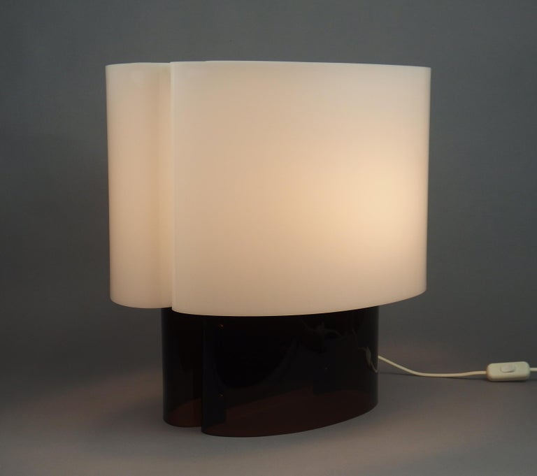 A plexiglass table lamp with a brown frame and a white shade, two lights in the shade, designed by Danielle Quarante and edited by Dire, circa 1970.