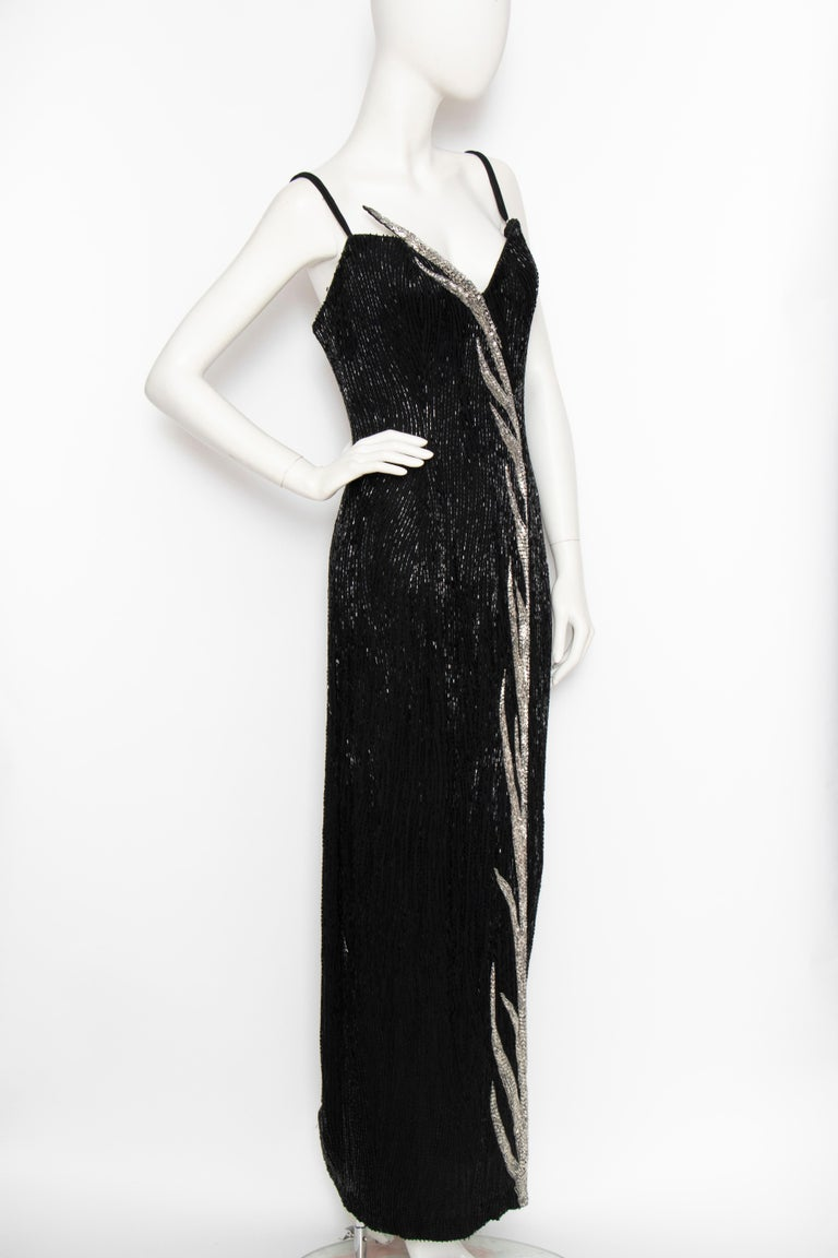 A glamorous 1980s Vintage Bob Mackie black beaded evening gown with sequins and beads in black and silver.