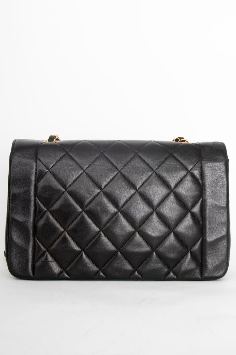 Women's or Men's A 1990s Chanel Black Quilted Lambskin Bag Gold Hardware For Sale