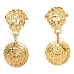 A 1990s Vintage Pair of Gold-Toned Gianni Versace Medusa Clip-On Earrings