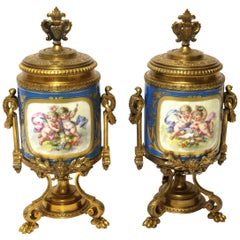 19th Century Pair of French Sèvres Style Hand Painted Porcelain and Ormolu Urns