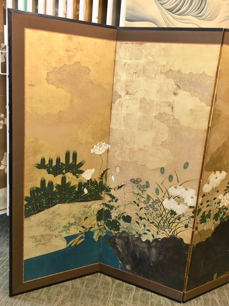 A six-panel Japanese screen with raised fence in gesso. Hand-painted on gold leaf.