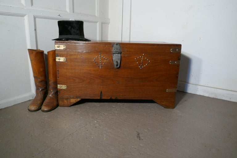 A 19th century brass bound campaign chest, secret interior