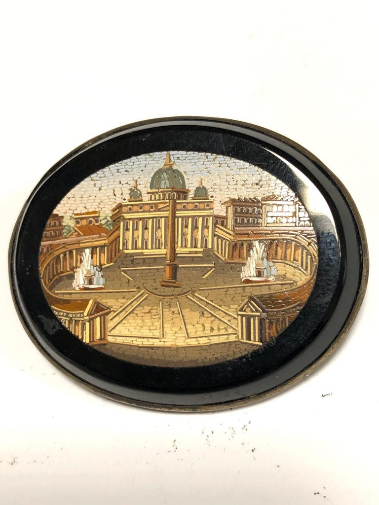 The oval micromosiac depicting St Peter's square, Rome with the Vatican and Bernini's colonnade, mounted in a gold frame