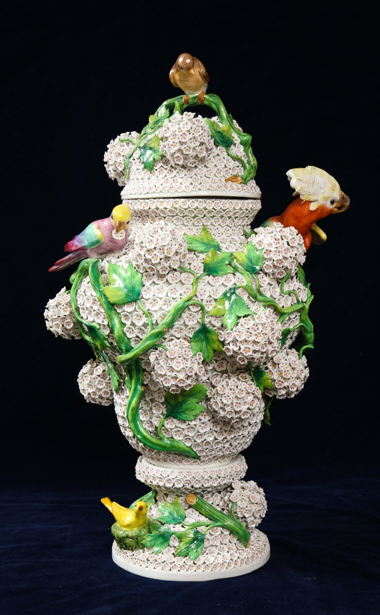 A fabulous and large 19th century Louis XVI Style Meissen Porcelain Schneeballen snowball vase decorated with vines, flowers, and Meissen birds. The vase is of bulbous-ovoid form, the exterior surface decorated with hundreds of intricately applied