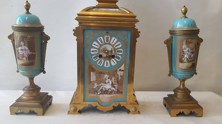 A beautiful turquoise Sèvres-style clock garniture, hand-painted on 18th century Sèvres porcelaine blanks but decorated in the 19th century most probably in the workshop of Émile Lévy in Paris.  The cartouches are after paintings by Vigée Lebrun,