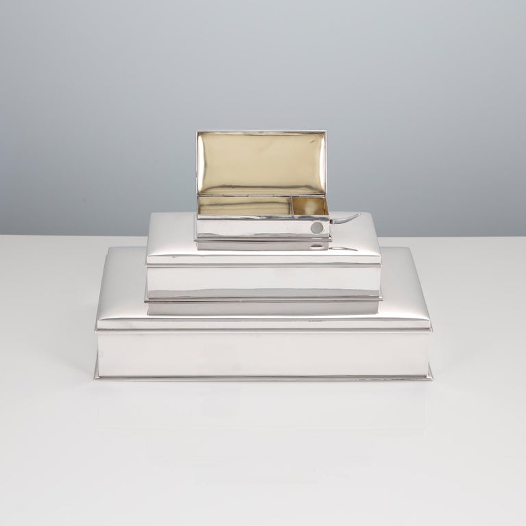 A 20th century sterling silver 3-tier cigar and cigarette box with vesta and & cigar cutter by Tiffany, American, circa 1930.  This piece is beautifully made with a high quality gauge of silver. The bottom compartment takes good size cigars & is
