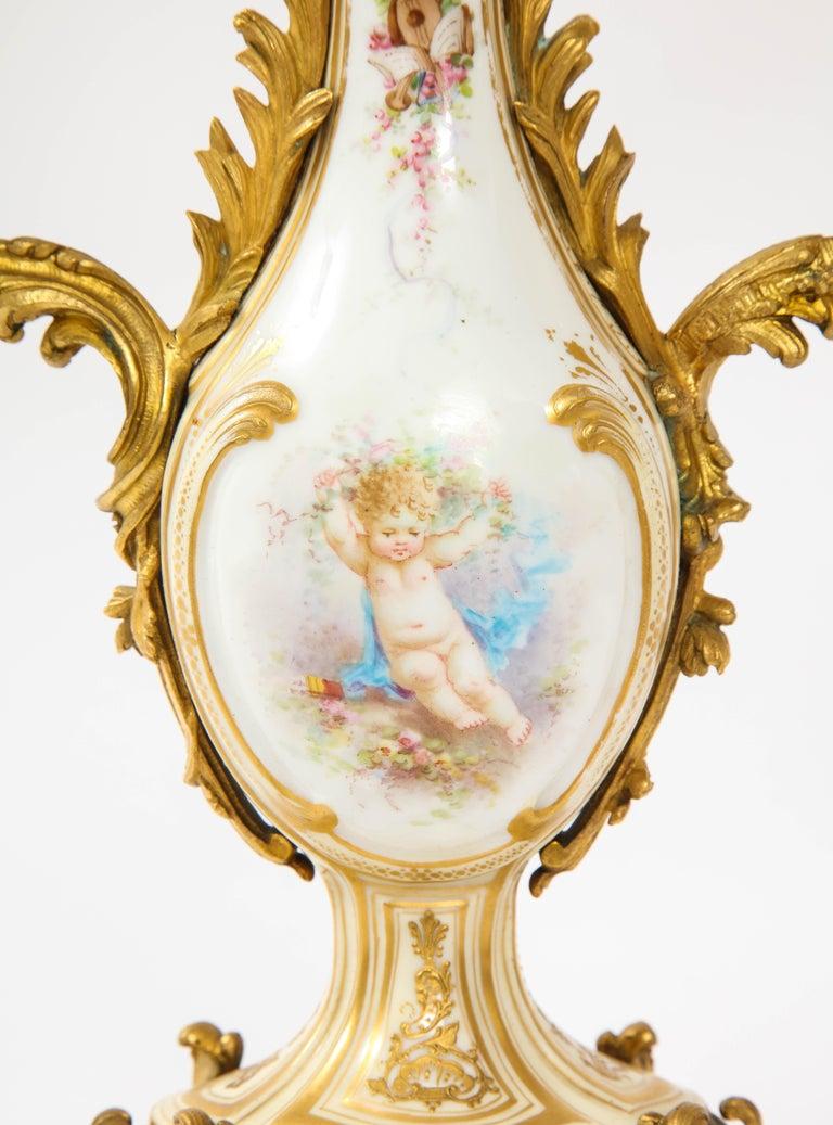 3-Piece Sevres Porcelain and Dore Bronze Mnt. Clock and Candelabra Garniture For Sale 3