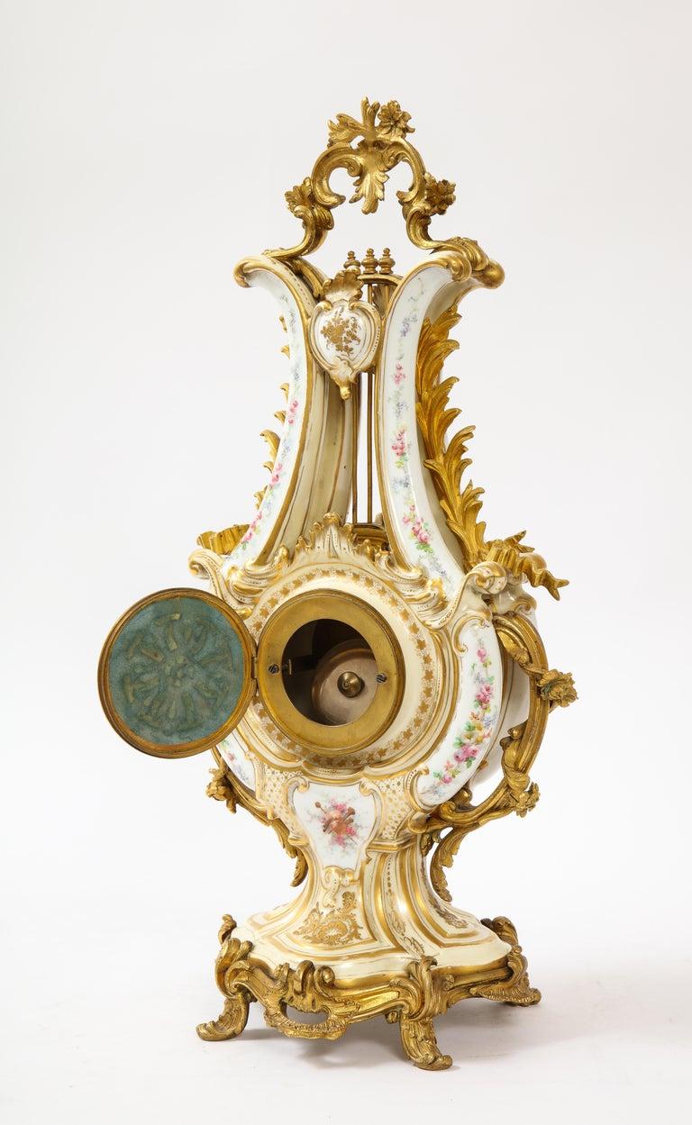 3-Piece Sevres Porcelain and Dore Bronze Mnt. Clock and Candelabra Garniture For Sale 8