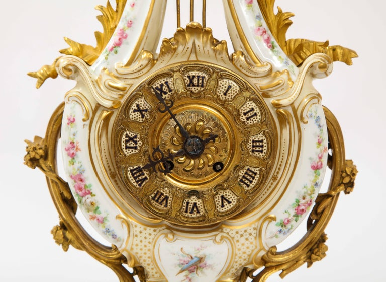 3-Piece Sevres Porcelain and Dore Bronze Mnt. Clock and Candelabra Garniture In Good Condition For Sale In New York, NY