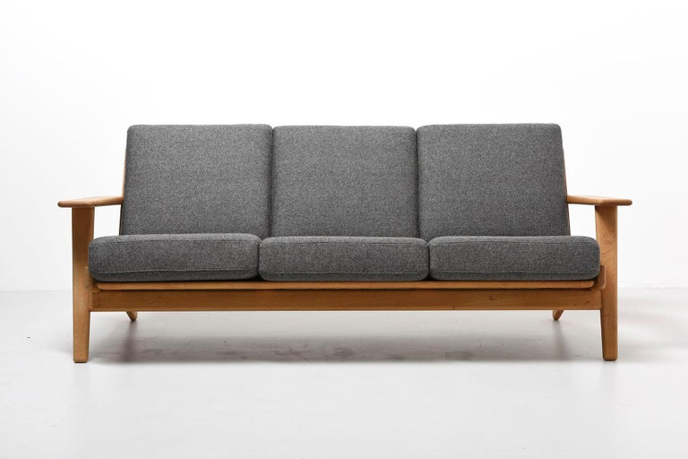 A 3-seat sofa designed by Hans J. Wegner in 1953. Model GE-290, produced by GETAMA in Denmark.