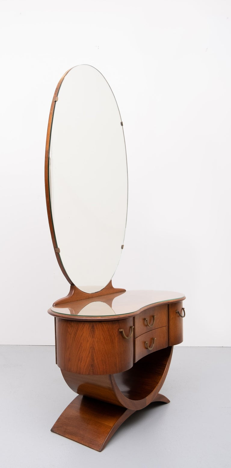 Love this vanity by A A Patijn for Zijlstra Joure Holland 1950s All these curves . very nice warm Nutwood color .Two curved anti dust drawers beautiful bronze handles. Glass plate on top. Good condition.  Comes with the original stool. Needs to be