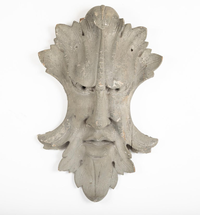 An architectural element featuring an Acanthus leaf surrounding a face.