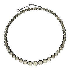A Beautiful Antique Diamond Riviere Necklace Set in Silver and Gold