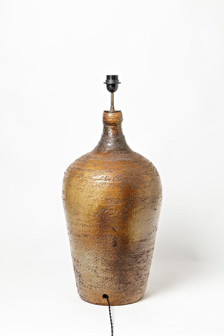 A big ceramic lamp signed