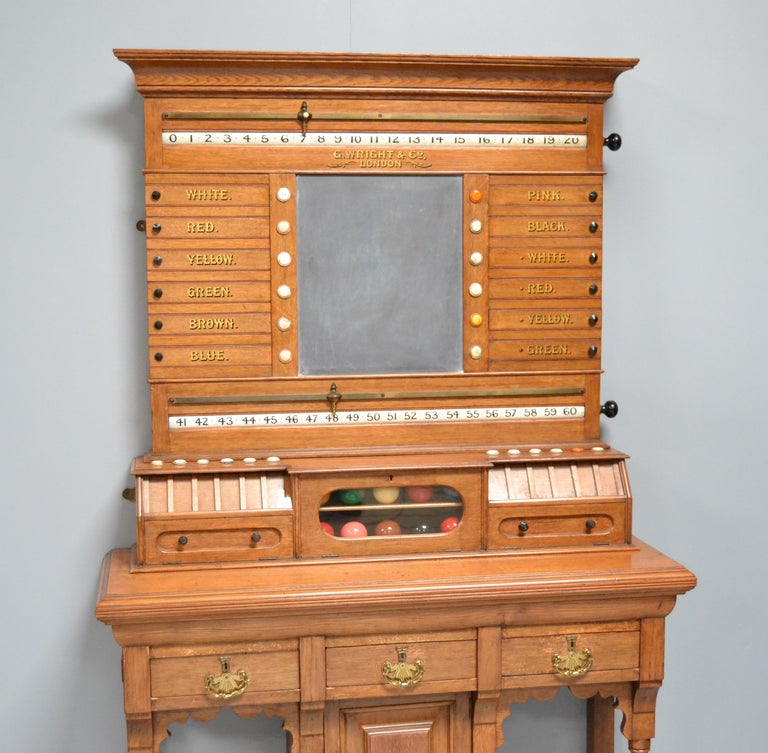 A solid oak free standing scoring cabinet by George Wright of London circa 1890. 