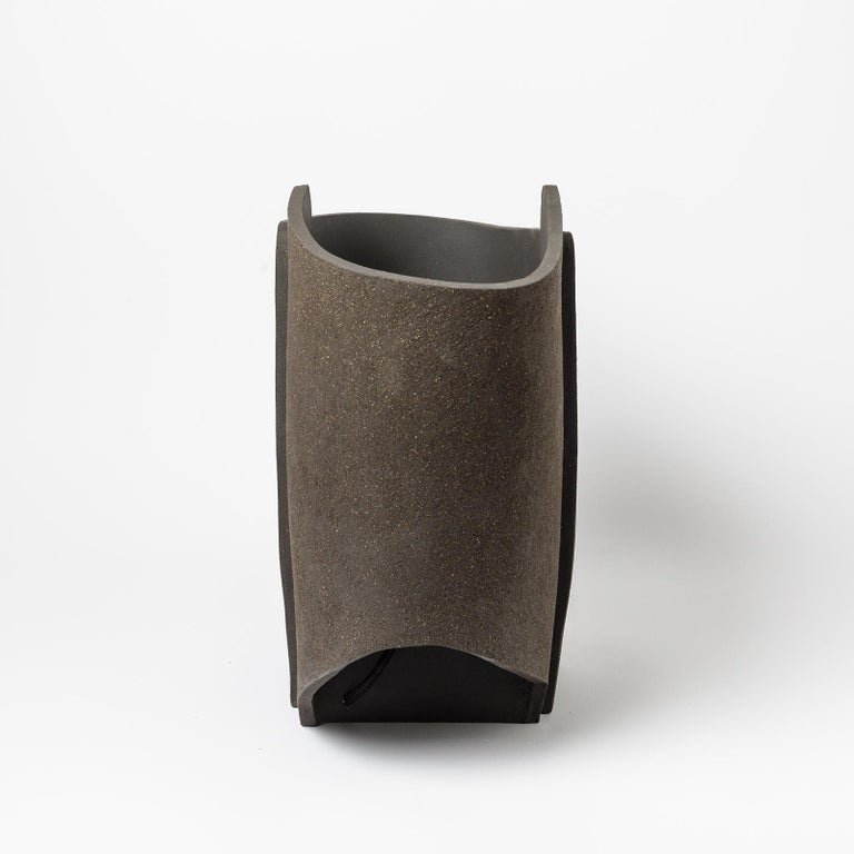 A black- brown ceramic table lamp by Denis Castaing. Perfect original conditions. Signed at the base. 2021. Sold with a new European electrical system.