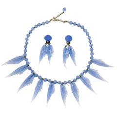 A bluebell blue moulded glass 'feather' motif' necklace and earrings, 1950s.