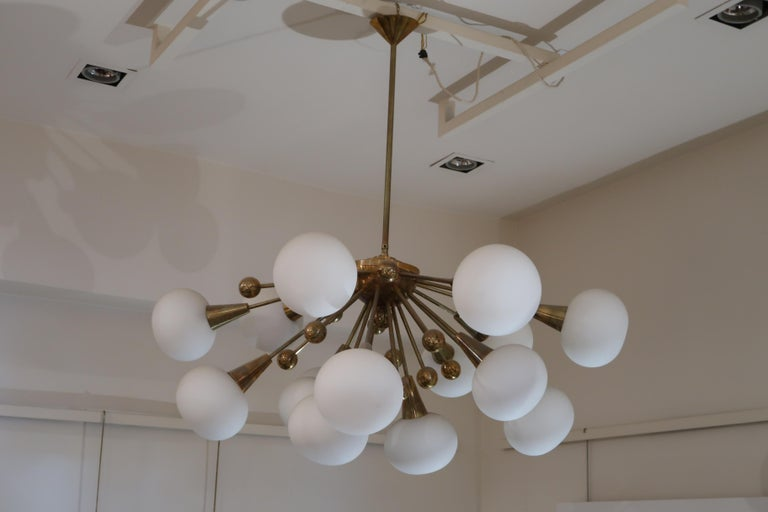 A brass and opaline glass midcentury Italian ceiling lamp, 1970.