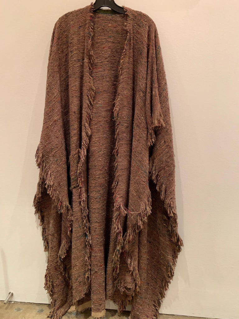 A beautiful, bohemian, cappuchino color hand-woven and over-dyed silk slubbed shawl or large wrap with fringed edges and various colors of fibers shot through the weave.  Earthy and gorgeous.