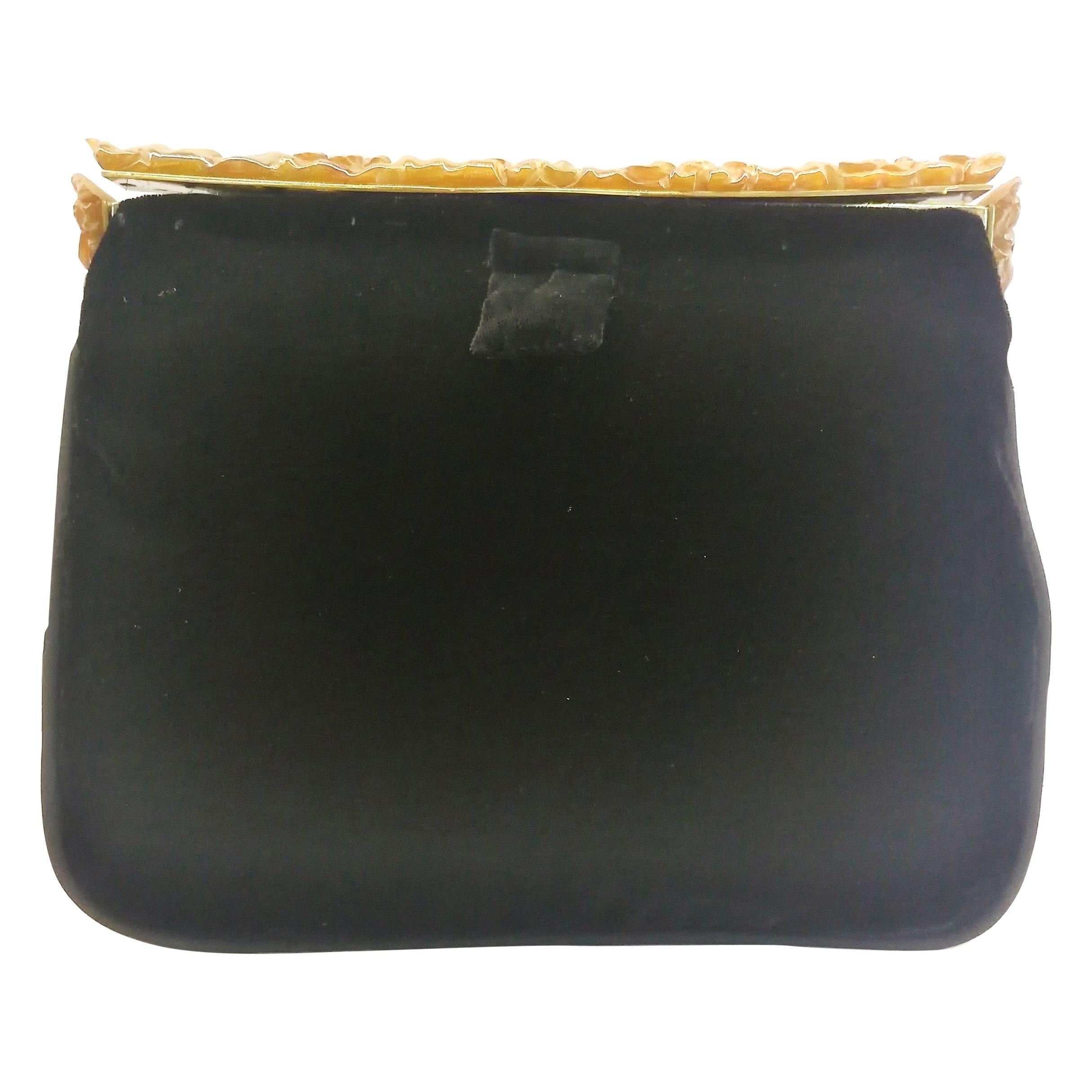 A carved amber Bakelite frame, and silk velvet clutch/handbag, 1930s.